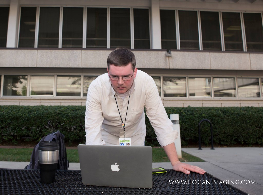 Photographer Jennifer Hogan captures me in the midst of checking in on social media and other news on Thursday, Oct. 9, as we await court orders legalizing same-gender marriage in North Carolina.