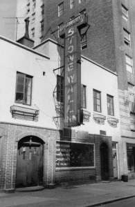 A photo of the Stonewall Inn, showing the Mattachine's sign in the aftermath of the riots. By photographer Diana Davies, archived in the New York Public Library.